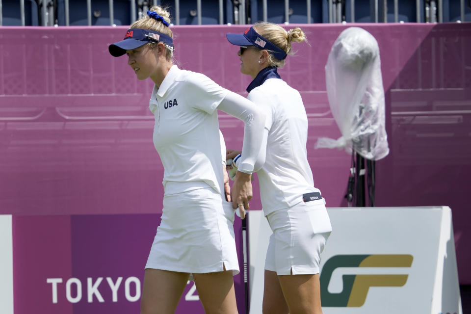 Nelly Korda, of the United States, right, and her sister, Jessica Korda, of the United States, prepare to play a practice round prior to the women's golf event at the 2020 Summer Olympics, Monday, Aug. 2, 2021, at the Kasumigaseki Country Club in Kawagoe, Japan, (AP Photo/Andy Wong)