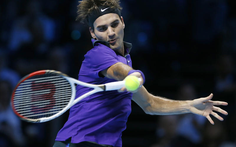 Roger Federer of Switzerland plays a return to David Ferrer of Spain during their ATP World Tennis Finals singles match in London Thursday, Nov. 8, 2012. (AP Photo/Kirsty Wigglesworth)