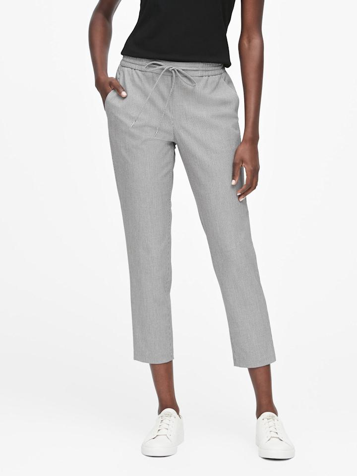 """<p>Style these <a href=""""https://www.popsugar.com/buy/Hayden-Tapered-Fit-Houndstooth-Ankle-Pants-499227?p_name=Hayden%20Tapered-Fit%20Houndstooth%20Ankle%20Pants&retailer=bananarepublic.gap.com&pid=499227&price=59&evar1=fab%3Aus&evar9=46730877&evar98=https%3A%2F%2Fwww.popsugar.com%2Ffashion%2Fphoto-gallery%2F46730877%2Fimage%2F46730891%2FHayden-Tapered-Fit-Houndstooth-Ankle-Pants&list1=shopping%2Cbanana%20republic%2Cfall%20fashion%2Cfall%2Cpants&prop13=mobile&pdata=1"""" rel=""""nofollow"""" data-shoppable-link=""""1"""" target=""""_blank"""" class=""""ga-track"""" data-ga-category=""""Related"""" data-ga-label=""""https://bananarepublic.gap.com/browse/product.do?pid=493017002&amp;cid=1113666&amp;pcid=67595&amp;vid=1&amp;grid=pds_64_158_1#pdp-page-content"""" data-ga-action=""""In-Line Links"""">Hayden Tapered-Fit Houndstooth Ankle Pants</a> ($59, originally $90) with sneakers and a blouse.</p>"""