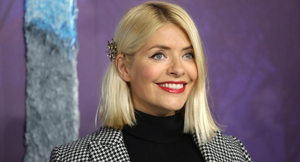 "<a href=""https://uk.news.yahoo.com/tagged/holly-willoughby/"" data-ylk=""slk:Holly Willoughby"" class=""link rapid-noclick-resp"">Holly Willoughby</a> has been able to host <em>This Morning </em>throughout the pandemic alongside Phillip Schofield, although they've had to keep their distance. This year also saw her announce she'd <a href=""https://uk.news.yahoo.com/holly-willoughby-quits-celebrity-juice-104213410.html"" data-ylk=""slk:be quitting Celebrity Juice;outcm:mb_qualified_link;_E:mb_qualified_link;ct:story;"" class=""link rapid-noclick-resp yahoo-link"">be quitting Celebrity Juice</a> after 12 years as a team captain. (Photo by Lia Toby/Getty Images)"