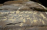"""<p>Think of this feature as a combination of South Dakota's Art Alley and the Petroglyphs in Minnesota. Over in Carbon County, Utah, you'll find the """"<a href=""""http://www.atlasobscura.com/places/nine-mile-canyon"""" rel=""""nofollow noopener"""" target=""""_blank"""" data-ylk=""""slk:world's longest art gallery"""" class=""""link rapid-noclick-resp"""">world's longest art gallery</a>."""" Measuring in at around 40 miles, the walls of this canyon (oddly named """"Nine Mile Canyon"""") bear pictographs and petroglyphs that range in date from the Fremont era (AD 1-1300) to the 19th century. </p>"""