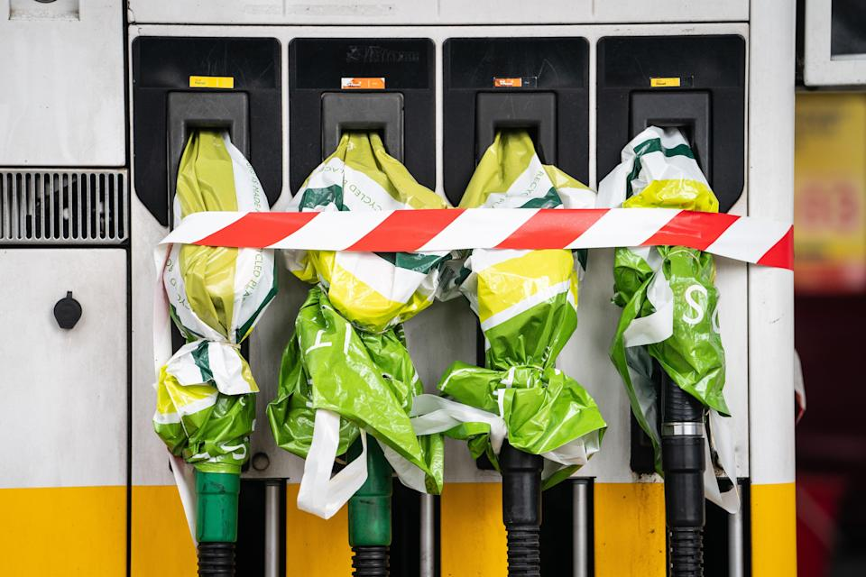 Closed off petrol pumps at a Shell petrol station in central London (Dominic Lipinski/PA) (PA Wire)