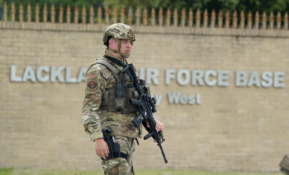 A military policeman stands guard at JBSA-Lackland Air Force Base game, Wednesday, June 9, 2021, in San Antonio. The Air Force was put on lockdown as police and military officials say they searched for two people suspected of shooting into the base from outside. (AP Photo/Eric Gay)