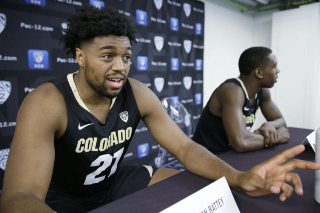 FILE - In this Thursday, Oct. 11, 2018, file photo. Colorado forward Evan Battey, left, and guard McKinley Wright IV take questions during the Pac-12 NCAA college basketball media day in San Francisco. Battey, a redshirt freshman from California, is preparing to take the court for the team, a debut delayed by almost a year after he suffered a stroke and two seizures last December during a pickup game with friends. (AP Photo/Eric Risberg, File)