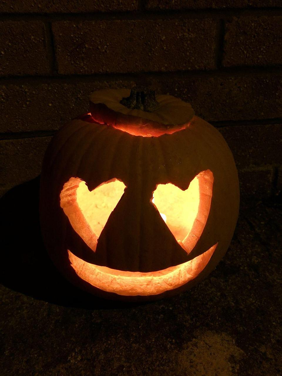 <p>Keep the carving simple with this popular emoji idea. The basic heart-shaped eyes and smile are easy to re-create.</p>