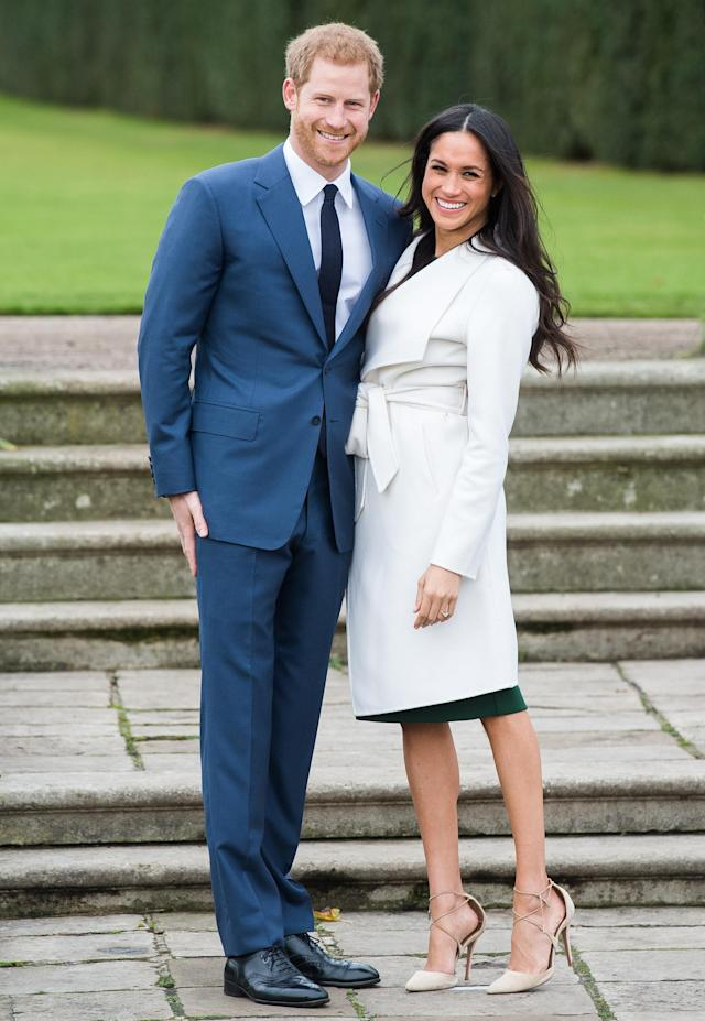 To announce her engagement to Prince Harry, Meghan Markle wore an emerald-green dress under her white coat. (Photo: Getty Images)