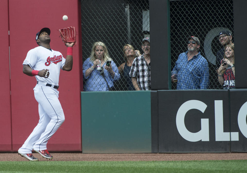 Cleveland Indians' Yasiel Puig catches a fly ball by Texas Rangers' Hunter Pence during the sixth inning of the first game of a baseball doubleheader in Cleveland, Wednesday, Aug. 7, 2019. (AP Photo/Phil Long)
