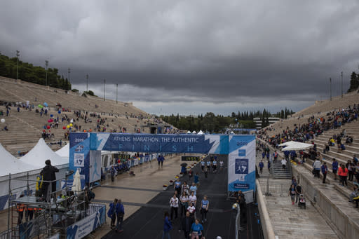 Clouds cover the sky over the Panathenean stadium during the 37th Athens Marathon, on Sunday, Nov, 10, 2019. (AP Photo/Yorgos Karahalis)
