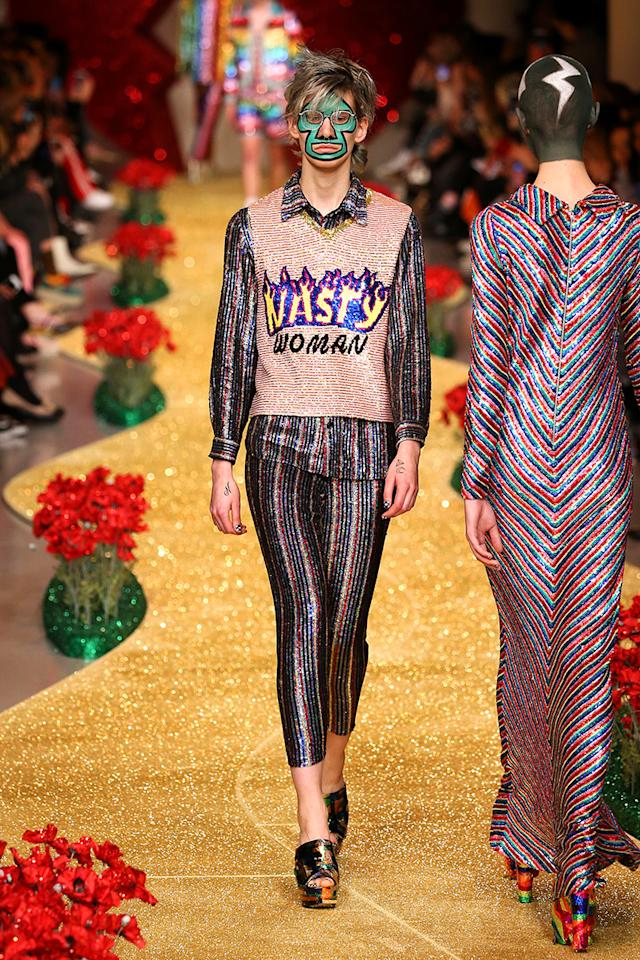 "<p>Ashish's political references become more explicit throughout his collection. The phrase ""nasty woman,"" a direct reference to Trump's comments on Hillary Clinton during a presidential debate, made an appearance on the runway. (Photo: Getty Images) </p>"