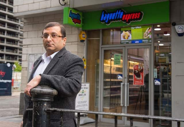 Ihsan Bashir outside his family's business in Docklands