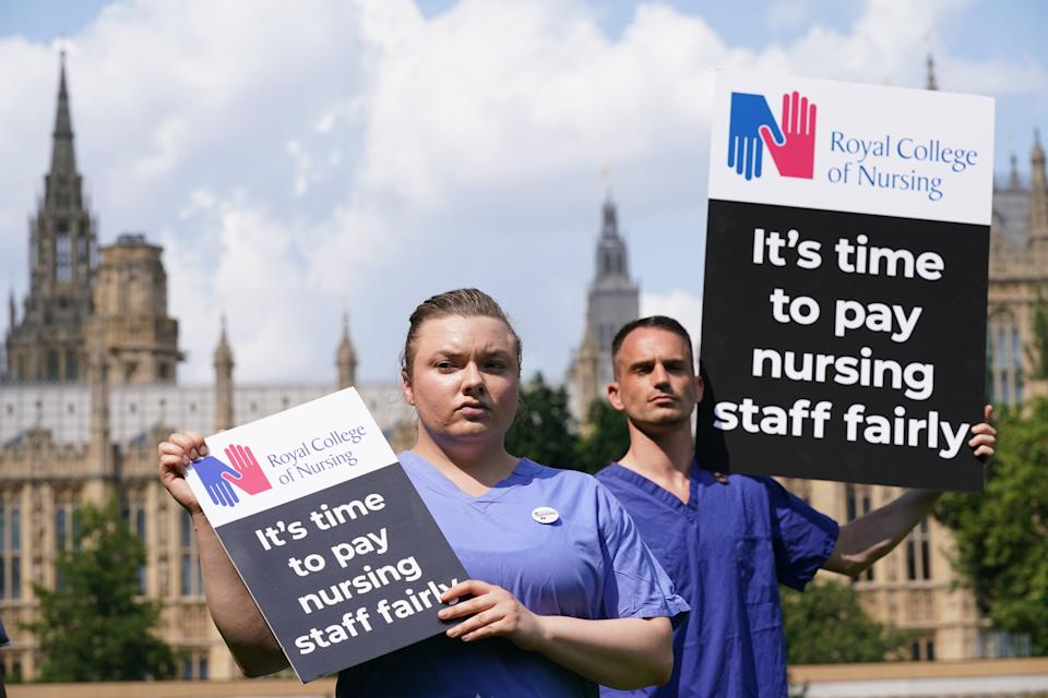 Nurses with placards outside the Royal College of Nursing in Victoria Tower Gardens, London (PA) (PA Wire)