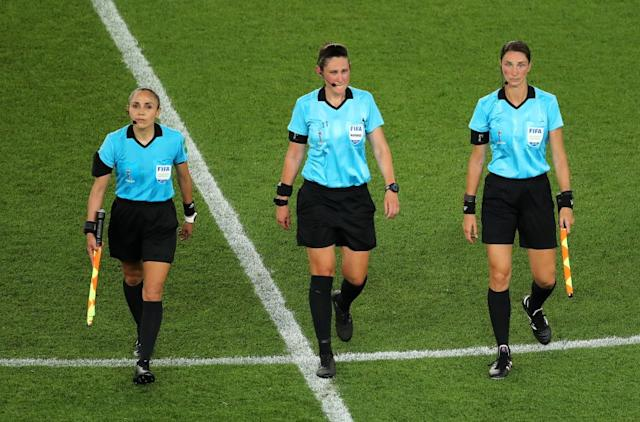 """From left, Felisha Mariscal, Kate Jacewicz, Kathryn Nesbitt, leave the pitch after the 2019 FIFA Women's World Cup match. Mariscal will be working the MLS Is Back tournament. <span class=""""copyright"""">(Marianna Massey / FIFA via Getty Images)</span>"""