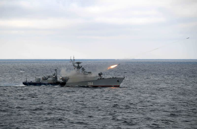 Russian anti-submarine corvette Muromets fires during the joint drills of the Northern and Black Sea fleets, attended by Russian President VladimirPutin, in the Black Sea, off the coast of Crimea