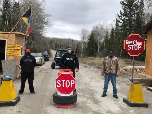 Sgt. Joe Gervais, centre, the detachment commander for Treaty Three Police Service in Grassy Narrows, and two staff at the checkpoint outside the Ontario First Nation monitor how much alcohol individuals are bringing into the community. (Submitted by Sgt. Joe Gervais - image credit)