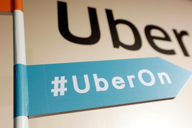 A sign is seen during a news conference to announce Uber resumes ride-hailing service, in Taipei