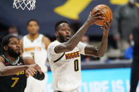 Denver Nuggets forward JaMychal Green, right, pulls in a rebound as Memphis Grizzlies forward Justise Winslow defends in the second half of an NBA basketball game Monday, April 26, 2021, in Denver. (AP Photo/David Zalubowski)