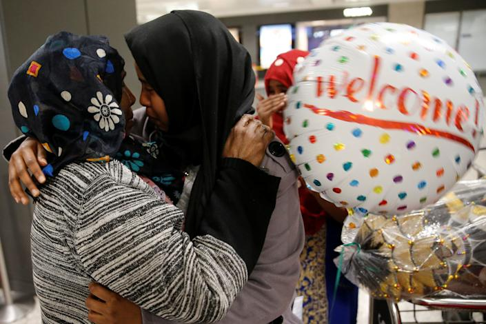 Roodo Abdishakur, left, a Somali national who was delayed entry to the U.S. because of the recent ban, is greeted by her mother, Zahra Warsma, at Washington Dulles International Airport on Feb. 6, 2017.