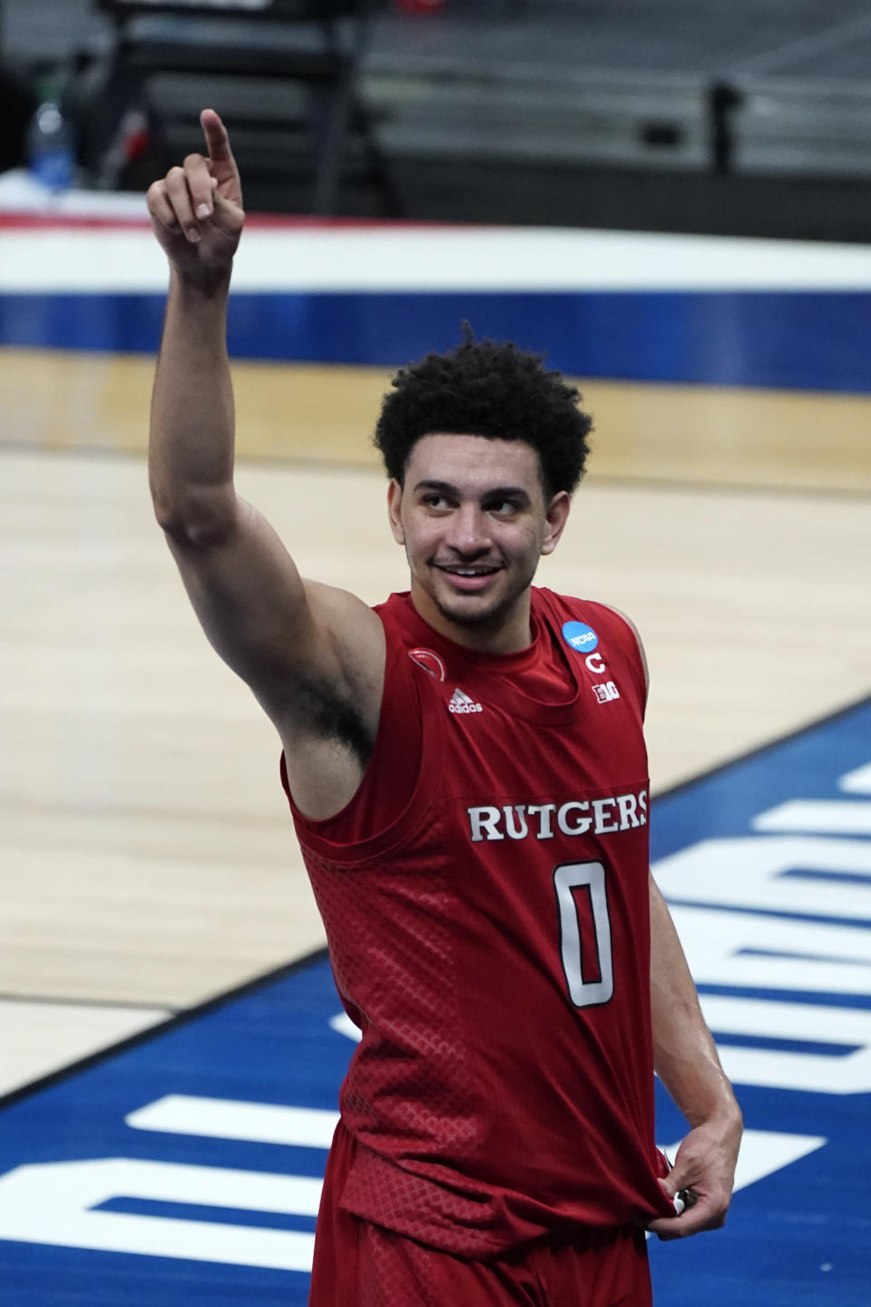 Rutgers guard Geo Baker (0) celebrates after beating Clemson 60-56 in a men's college basketball game in the first round of the NCAA tournament at Bankers Life Fieldhouse in Indianapolis, Friday, March 19, 2021. Rutgers won 60-56. (AP Photo/Paul Sancya)