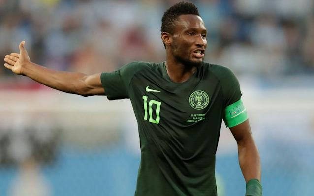 John Obi Mikel in action against Argentina, hours after discovering his father had been kidnapped - REUTERS