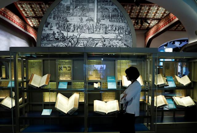 A visitor looks at various Bibles during a preview at the Museum of the Bible on Nov. 14. (Kevin Lamarque/Reuters)
