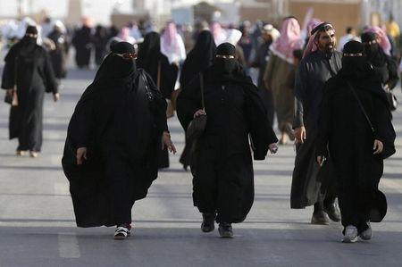 Saudi women arrive to attend Janadriyah Culture Festival on the outskirts of Riyadh