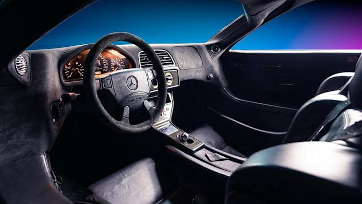 The Benz still sports a retro dash with analog gauges. - Credit: Gooding & Company