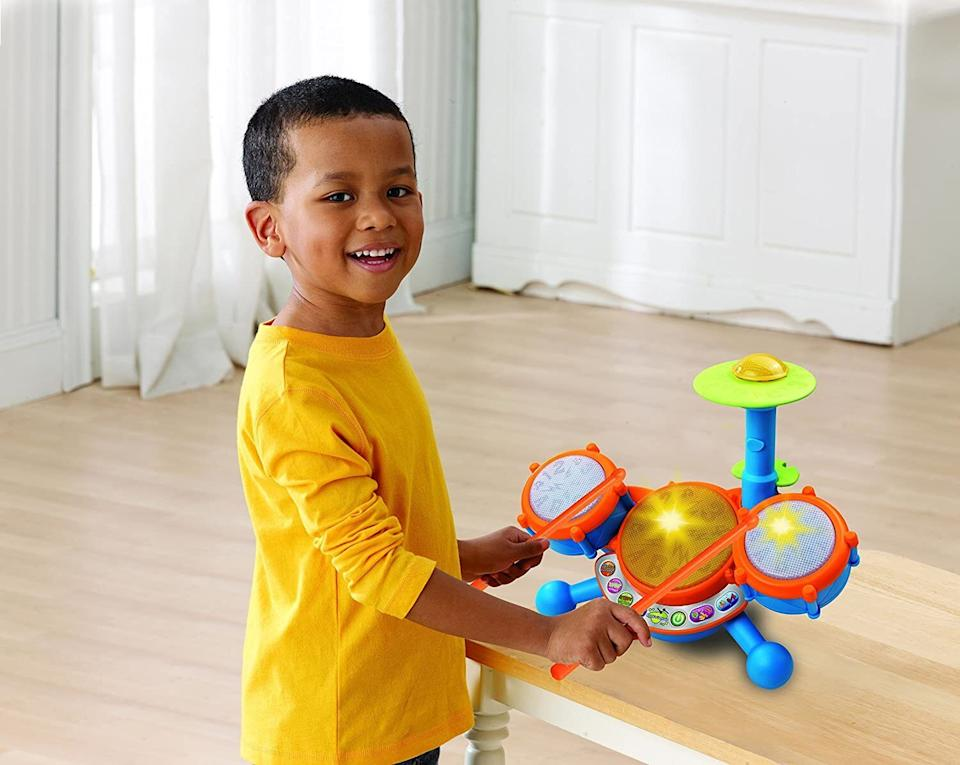 """Trust that this is not as noisy as it looks. Your kid can freestyle with this (like Animal from the Muppets) or they can follow the lights as they learn about letters and numbers.<br /><br /><strong>Promising review:</strong>""""There are times when you know your kid is going to love something so much that you overlook just how very ridiculously annoying that thing can be? Well, I'm sure glad I took a gamble! This toy is not really as annoying as I thought it would be. I haven't needed to hide it away or remove the batteries. In fact, I've recommended it in my mommy group to moms with other toddlers my kid's age.<strong>My son has yet to figure out how to change the volume but even in the loudest setting, it isn't super loud. Just loud enough.</strong>I can't hear it when he plays with it and I'm in the next room."""" —<a href=""""https://amzn.to/3xhRKQL"""" target=""""_blank"""" rel=""""noopener noreferrer"""">Captainmaddux</a><br /><strong><br />Get it from Amazon for<a href=""""https://amzn.to/3dH8l8T"""" target=""""_blank"""" rel=""""noopener noreferrer"""">$17.99</a>(available in two colors).</strong>"""