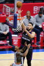 Philadelphia 76ers' Ben Simmons, right, goes up for a shot against Washington Wizards' Bradley Beal during the first half of Game 2 in a first-round NBA basketball playoff series, Wednesday, May 26, 2021, in Philadelphia. (AP Photo/Matt Slocum)