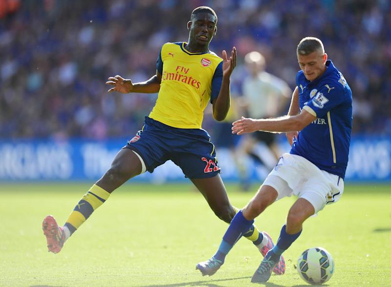 Arsenal's Yaya Sanogo (L) fights for the ball with Leicester City's Paul Konchesky during their English Premier League match, at King Power Stadium in Leicester, central England, on August 31, 2014