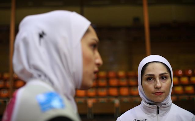 "Iranian volleyball players Maedeh Borhani (L) and Zeinab Giveh talk during an interview following a training session of ""Shumen"" volleyball club in Shumen, Bulgaria January 14, 2017. Picture taken on January 14, 2017. REUTERS/Stoyan Nenov"