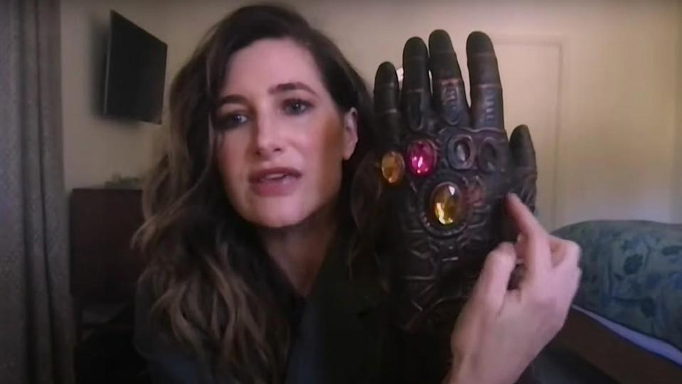 Kathryn Hahn holds up a toy Thanos glove in a clip from Late Night with Seth Meyer.
