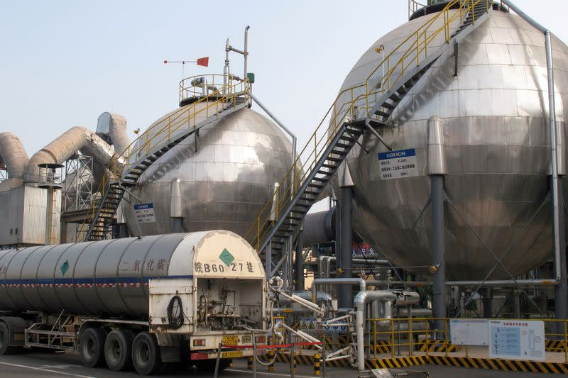 FILE PHOTO: Carbon dioxide storage tanks are seen at a cement plant and carbon capture facility in Wuhu