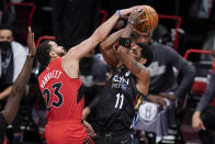 Toronto Raptors' Fred VanVleet (23) defends against Brooklyn Nets' Kyrie Irving (11) during the first half of an NBA basketball game Friday, Feb. 5, 2021, in New York. (AP Photo/Frank Franklin II)