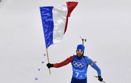 Brilliant Fourcade claims mixed relay gold for France