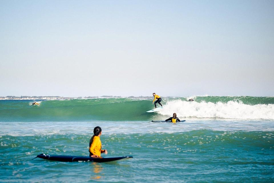 Surfing at Muizenberg with Stoked Surf School