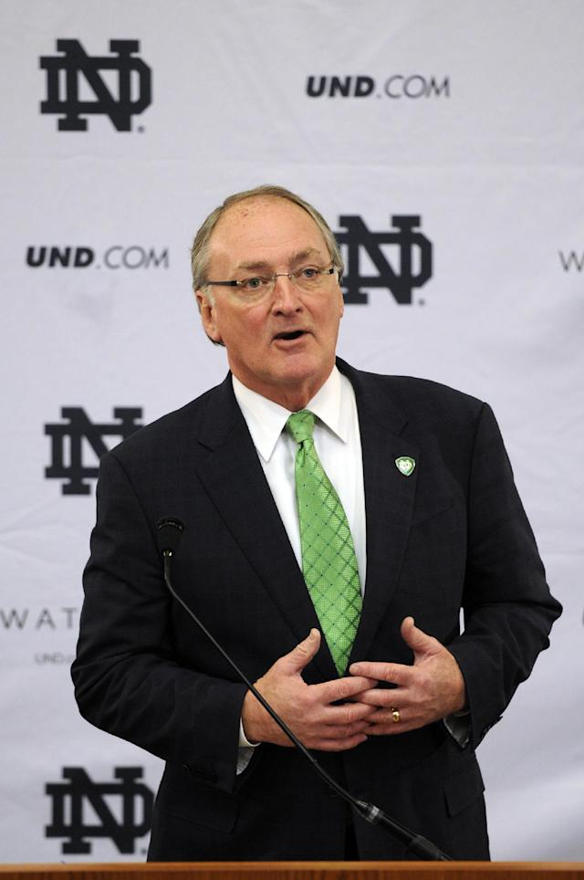 Jack Swarbrick, Notre Dame Vice President and Director of Athletics, speaks during a news conference Tuesday, Jan. 21, 2014, in South Bend, Ind., announcing an agreement between Notre Dame and Under Armour that will outfit the university's athletic teams (AP Photo/Joe Raymond)