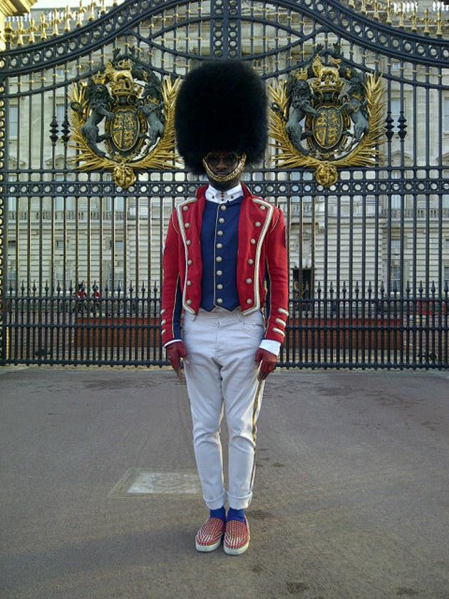 "Celebrity photos: will.i.am really got into the Jubilee festivities last weekend and seemed pretty excited ahead of his performance at the Jubilee Concert. He tweeted this image of him standing outside Buckingham Palace dressed as a guard. He captioned it: ""brit.i.am…I don't think ill ever be the same again...#iambritish"" [sic]"