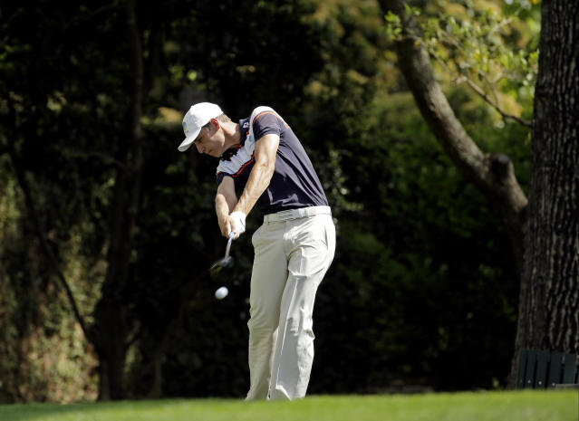 Oliver Goss, of Australia, tees off on the second hole during the fourth round of the Masters golf tournament Sunday, April 13, 2014, in Augusta, Ga. (AP Photo/Charlie Riedel)