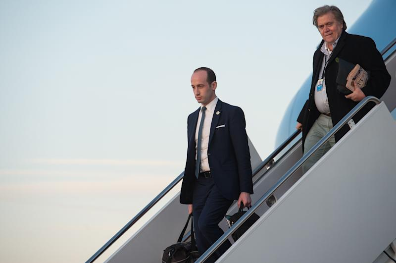 Stephen Miller (left) and Steve Bannon step off Air Force One at Andrews Air Force Base in Maryland in March. (NICHOLAS KAMM via Getty Images)