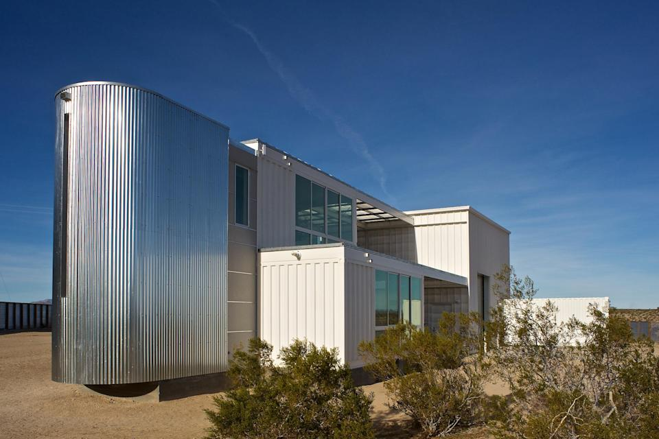 Ecotech Design built this prototype hybrid house in the Mojave Desert using six shipping containers, which were fabricated in Los Angeles, then stacked in pairs at the site. Five containers are home to living spaces and the sixth is connected to the photography studio and provides equipment storage.