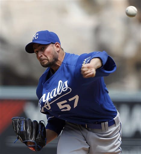 Kansas City Royals starter Jonathan Sanchez pitches to the Los Angeles Angels in the first inning of a baseball game at Anaheim, Calif., Sunday, April 8, 2012. (AP Photo/Reed Saxon)