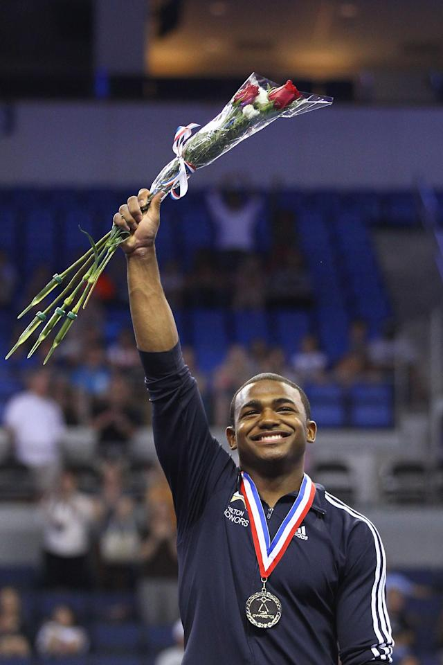 ST. LOUIS, MO - JUNE 9: John Orozco acknowledges the crowd after receiving his gold medal in the Senior Men's competition on Day Three of the Visa Championships at Chaifetz Arena on June 9, 2012 in St. Louis, Missouri. (Photo by Dilip Vishwanat/Getty Images)