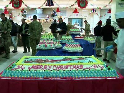 International troops in Afghanistan celebrated Christmas day with a traditional Christmas meal at Kabul International Airport in a dining hall packed with soldiers from the United States, France and Germany. (Dec. 25)