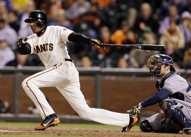 San Francisco Giants' Joaquin Arias drives in a two runs after a fielding error from Milwaukee Brewers third baseman Jeff Bianchi during the eighth inning of a baseball game on Monday, Aug. 5, 2013, in San Francisco. (AP Photo/Marcio Jose Sanchez)