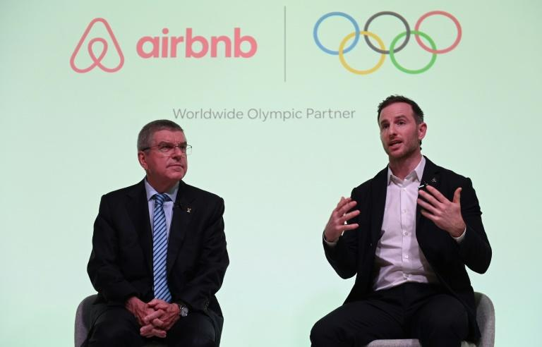 IOC President Thomas Bach, left, announced the deal at a London press conference with Airbnb co-founder Joe Gebbia on Tuesday