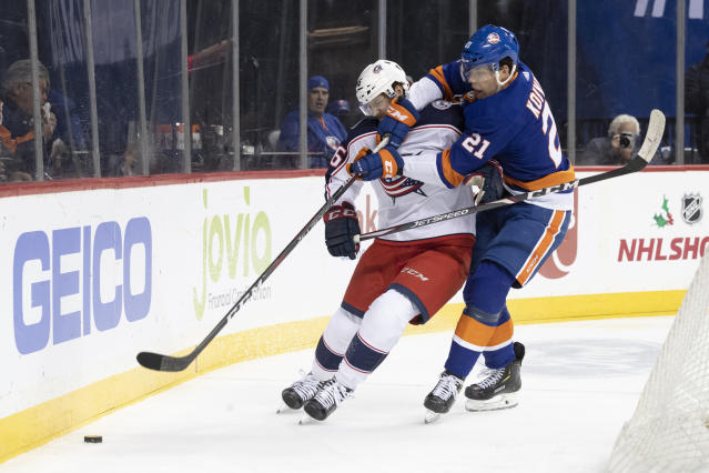 New York Islanders left wing Otto Koivula (21) fights for the puck against Columbus Blue Jackets defenseman Dean Kukan (46) during the second period of an NHL hockey game, Saturday, Nov. 30, 2019, in New York. (AP Photo/Mary Altaffer)
