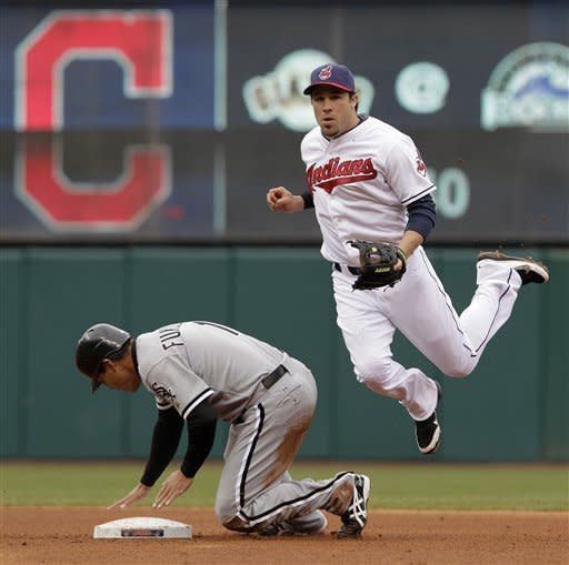 After forcing Chicago White Sox's Kosuke Fukudomeat second, Cleveland Indians second baseman Jason Kipnis leaps as he throws to first to double up batter Gordon Beckham in the fourth inning of a baseball game in Cleveland on Wednesday, April 11, 2012. (AP Photo/Amy Sancetta)