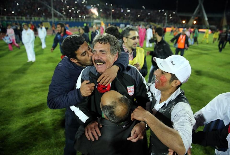 Fans mob Tractor Sazi head coach Toni Oliveira on May 15, 2015, moments before celebrations turned sour when they realised they had not won the Iranian Premier League title after all (AFP Photo/Omid Vahabzadeh)