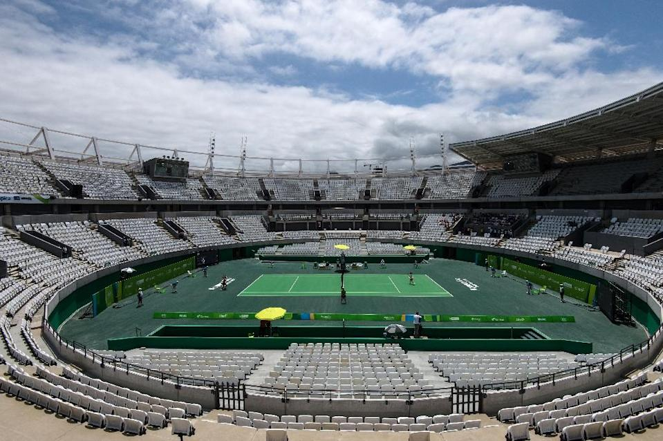 Despite an economic crisis communications director for the Rio-2016 Olympic organizing committee, Mario Andrada, said it will not cut back on tracks, sports, the ceremony, or the legacy of the Games (AFP Photo/Yasuyoshi Chiba)