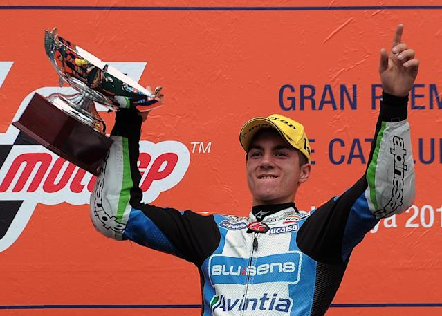 Blusens Avintia Spanish Maverick Vinales celebrates on the podium after winning the Moto3 race of the Catalunya Moto GP Grand Prix at the Catalunya racetrack in Montmelo, near Barcelona, on June 3, 2012. Blusens Avintia's Spanish Maverick Vinales won the race ahead of Red Bull KTM Ajo's German Sandro Cortese and Estrella Galicia's Portuguese Miguel Oliveira. AFP PHOTO / LLUIS GENELLUIS GENE/AFP/GettyImages
